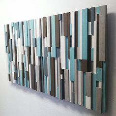 Artist: Eric WaddingtonTitle: 'Cooling Strips'Style: Modern Wood Art / Wood Strip Art / Wooden Wall ArtColors: Turquoise, Brown, White, Grey, Charcoal Handmade itemShips worldwide from Cincinnati, OhioNote: the original has been sold, but I can recreate a similar variation with the same colors and structure Materials: wood strips, wood backing, variety of paint colors, picture hanging wire Care instructions: Hang on nail, screw, MonkeyHook, or other picture hangers. Clean w&...