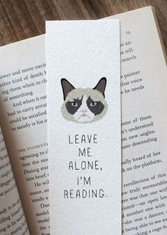 15 Perfect Bookmarks for Book Lovers This adorable bookmark would make the perfect gift for a reader or grumpy cat fan! Featuring a Wonderflies illustration of the famous grumpy cat, it reads: Leave me alone, I'm reading. DETAILS -Bookmark is 2 Bookmarks For Books, Creative Bookmarks, Cute Bookmarks, Paper Bookmarks, Crochet Bookmarks, Bookmarks Quotes, Reading Bookmarks, Handmade Bookmarks, Diy Marque Page