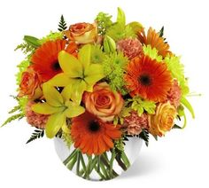 Fall bouquet in a bubble bowl vase filled with Asiatic Lilies, Gerbera Daisies, Roses and more.