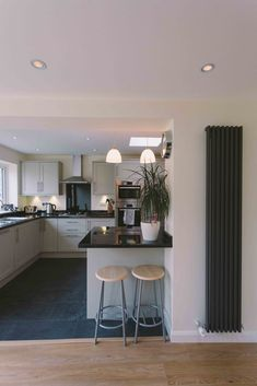 Radiator beside study desk by dining table instead of gas heater - frees up long low cupboard space opposite Small Kitchen Diner, Kitchen Diner Extension, Small Kitchen Tables, Open Plan Kitchen Living Room, Kitchen Tops, Kitchen Layout, New Kitchen, Kitchen Decor, Kitchen Grey