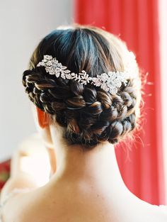 We love this bridal look! A braided up do teamed with the 'Flora' vine hairpiece