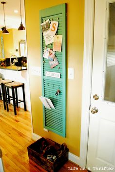 Love this idea of using an old shutter as a place to put mail and other things!