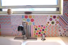 You can fake the look of colorful tile for less than $20 using heavyweight scrapbook paper. To do, apply each sheet one at a time using a water-resistant decoupage glue and sealer such as Mod Podge Outdoor. When it's time to remove your creation, spray it down with water to make peeling off easier.
