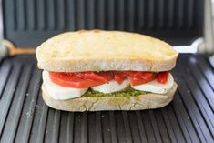 Homemade Grilled Mozzarella Sandwich with Walnut Pesto and Tomato that's easy to assemble and bursting with flavor - lunch never looked so good! Grill Sandwich, Toast Sandwich, Mozzarella Sandwich, Pesto Sandwich, Sandwich Recipes, Healthy Breakfast Snacks, Green Pesto, Walnut Pesto, Healthy Sandwiches
