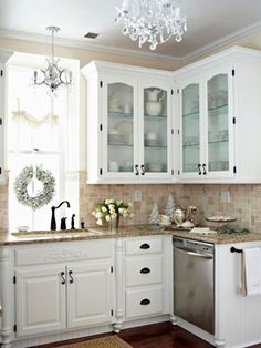 Beautiful white cabinets with black hardware, tan granite and backsplash. Two chandeliers! So many beautiful farmhouse chic kitchen style ideas. Peeking thru The Sunflowers: Midwest Living article Kitchen Redo, New Kitchen, Kitchen Remodel, Kitchen Dining, Kitchen Ideas, Kitchen White, Kitchen Corner, Kitchen Sinks, Kitchen Backsplash