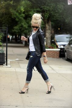 leather jacket, skinny jeans folded with a high strappy heel, white tee, glittery necklace.