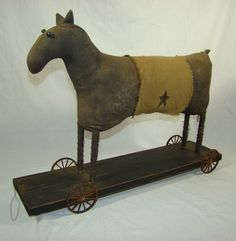 primitive style horse on wheels...