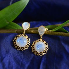 These exquisite earrings have been handmade in our workshops. We have used jaali and embossed work and embedded the earrings with rainbow moonstones. They are made in sterling silver with 24ct gold vermeil.  This is a limited edition and the earrings have a matching bracelet, pendant and ring.  Earrings dimension - 39mm from top of earrings x 22mm wide.  They have a butterfly push back.  Moonstone Earrings, Pendant Necklace, Drop Earrings, Alternative Wedding Jewellery, Rainbow Moonstone, Moonstones, Sterling Silver, Bracelets, Gold