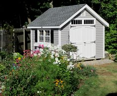 The landscaping around this Kloter Farms 10' x 10' English Garden Shed is beautiful! Outdoor Buildings, Outdoor Structures, Shrubs For Landscaping, Pond Construction, Free Shed, British Garden, She Sheds, Garden Show, Shed Design
