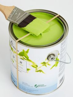 Stretch a rubber band over the top of a paint can and use it to wipe excess paint from the brush- Good Tip!