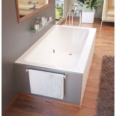 The Soho series bathtub is sculpted in a contemporary style that allows for a soothing soak with a modern twist. Apron style construction combines design features of a freestanding bathtub, with a built-in front skirt panel and open sides for custom finishing.