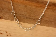 Really pretty, dainty silver necklace with lots of hearts linked together with a double strand chain.  Perfect for wearing all the time. 16