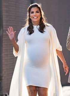 Pregnant Eva Longoria appeared in a tight dress and the world paused for a moment