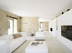 Living Room in Italy ~ Love the white with the warm exposed brick and the bright light from the windows ~ Casa Olivi by Wespi de Meuron Architekten