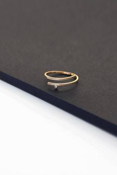 Solid gold coil ring tiny diamond engagement ring