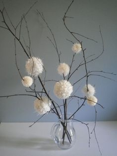 white yarn pom poms as daisy cotton flowers