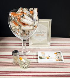 Sweet Lips Natural Lip Balm displayed in an over-sized wine glass. Check back for more display ideas. waxingkara.com