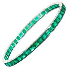 Art Deco Colombian Emerald Bangle. A Colombian emerald bangle of exceptional quality with approx 23cts of emeralds.