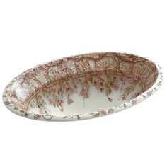 Abloom with an ornate floral pattern, Tale of Briar Rose draws its inspiration from the graceful beauty of climbing roses and their frequent appearance in classic literature. The enchanting design depicts nine verses from the fairy tale of Sleeping Beauty, framed by a bramble of English roses in soft shades of pink, green, and brown. This Centerpiece sink features a unique wide-beveled ledge and generous basin size.