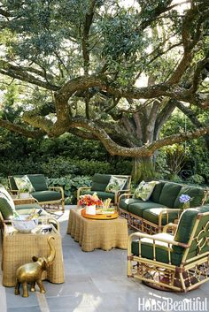 Love the tree that guards this patio. pieces from Celerie Kemble's Lane Venture collection furnish a new flagstone patio. Outdoor Rooms, Outdoor Dining, Outdoor Furniture Sets, Outdoor Decor, Rattan Furniture, Outdoor Patio Designs, Patio Ideas, Bbq Ideas, Flagstone Patio