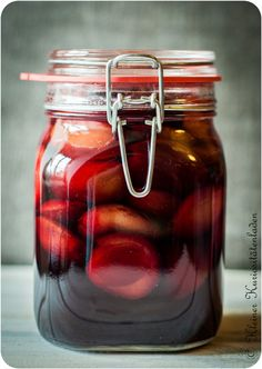 Rotwein-Zwetschen, eingeweckt- recipe for canning plums in red wine. Can translate to English if needed.