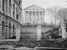 Custom House (left) and Virginia State Capitol (center); rubble in street in Richmond, VA