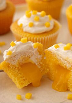 Mango-Cream Cupcakes – Prepare to be declared the winner of the next block-party dessert bake-off! These moist and luscious cupcakes open to reveal a creamy mango filling. Mango Cupcakes, Mango Cake, Yummy Cupcakes, Yellow Cupcakes, Mango Fruit, Block Party Desserts, No Bake Desserts, Just Desserts, Delicious Desserts