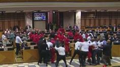 Image copyright                  RSA                  Image caption                     Security guards were ordered to evict politicians from the EFF party, in the red boiler suits   A brawl broke out in the South African parliament on Tuesday as security officers were ordered to forcibly remove opposition MPs. Several punches were thrown as the left-wing Economic Freedom Fighters (EFF) were expelled after trying to stop President Jacob Zuma speaking. In M