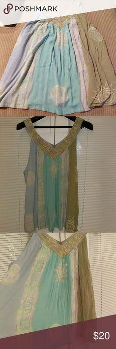 Sleeveless blouse Gauzy, flowy vneck sleeveless blouse in soft beachy pastels. Tops Blouses
