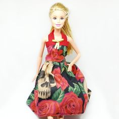 Barbie Dress - Vintage Style Doll Dress – Barbie Rockabilly Outfit - Barbie Custom Fashion Dress - Dia de Los Muertos - Skulls and Red Roses This gorgeous retro spooky cute swing dress is perfect for sassy Barbie in a black and red skulls and rose print. The skirt is full and flirty making it the perfect dress for dancing.  The entire back of this Barbie gown opens up for easy wearing (no more struggling with dressing Barbie) and closes with specialty doll Velcro that will make it easy for…