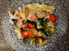 3tablespoons butter 2 tablespoons all-purpose flour1/2 teaspoon salt1 cup milk2 pounds red snapper fillets 1/2 pound cooked medium shrimp, peeled and deveined 1/4 cup grated Parmesan cheese  http://allrecipes.com/recipe/12736/baked-fish-with-shrimp/