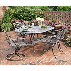@Overstock - Beautify your porch, deck, or yard with this outdoor cast-aluminum dining set. Featuring a taupe oval dining table, four arm chairs, two swivel chairs, and a center umbrella opening, this set has a contemporary flair that is sure to draw attention.  http://www.overstock.com/Home-Garden/Home-Styles-Malibu-Cast-Aluminum-Taupe-7-piece-Outdoor-Dining-Set/6695052/product.html?CID=214117 $1,184.59