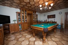 game room with the pool table
