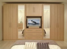 23 Admirable Wardrobe Designs To Inspire You : Wall Units Beautiful Great Wood Finishes Wardrobe Design with TV and Drawer in the Center