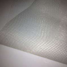 Self-Adhesive mesh will make your next tile project easier!  This mesh has a light adhesive on one side that is surprisingly strong!  Use it to create your mosaic design prior to installation.  Available at Mosaic Tile Mania.