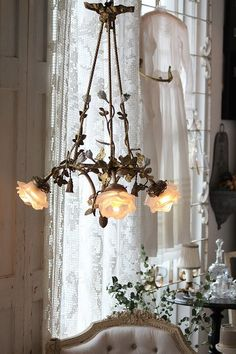 french antique bronze chandelier and frosted glass rose lamp shades