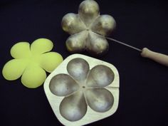Flower Molds are used for making artificial flowers and giving a real vein or curves. https://www.facebook.com/YapayCicekKaliplari -My molds which have wooden handles are made by brass casting. -The casting models are mine own design. -I can create different private molds by a photograph, sample flower leaf or a dimensioned drawing.After I see any sample