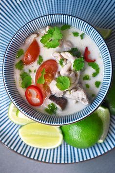 Tom Kha Gai, a popular Thai Coconut Chicken Soup, is super simple to make at home! This Whole30-friendly version is delicious and quick enough to make for a weeknight supper!
