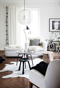 Nordic-inspired living room design. Love all of the soft colors.