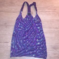 Purple tank with rope straps Super cute tank from Forever21, love the rope straps. Part of it has started to come off, shown in photo. But could easily be fixed with glue or be sewn back. Other than that it's in good condition. Forever 21 Tops Tank Tops