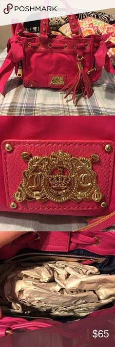 Juicy Couture hand bag Hot pink with gold accents. Has bows on each side never carried. Juicy Couture Bags Shoulder Bags