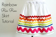 "Last Month we were able to Share our Rainbow Ric Rac Skirt Tutorial  over at The Crafting Chicks and today we get to share it back over here on our site! Hello Crafting Chicks Readers! We are so excited to be here today sharing a super simple ""Rainbow Ric Rac Skirt"" Tutorial.   Recently my...Read More »"