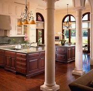 Contrasting brown cabinets with light uppers. Double islands allow for food prep and entertaining