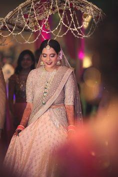 Bridal Colors - Pastel - Gold and Pink Pastel Lehenga with Satlada Haar | WedMeGood | Bride in a Gold Blouse and Pastel Pink Lehenga with Double Dupatta and Satlada Haar #wedmegood #indianbride #indianwedding #pastel #gold #satlada #pink #lehenga