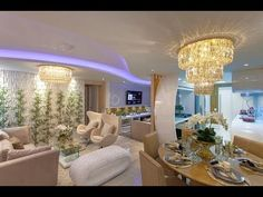 Living area modern living room by splendid interior designers pvt.ltd modern Luxury Homes Interior, Interior Design, Living Area, Living Room, Home Tv, Chandelier, House Design, Ceiling Lights, Inspiration