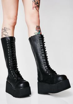 Demonia Stomp You Out Platform Boots at Dolls Kill, an online punk, goth, rave, kawaii, and streetwear clothing store. FAST & FREE WORLDWIDE SHIPPING. Shop trends and your favorite brands like Lime Crime, Wildfox Couture, Killstar, BOY London, and Y.R.U.