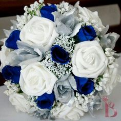 Blue Wedding Flowers I like this one. Disney blue and silver wedding colors bouquet. Prom Flowers, Purple Wedding Flowers, Rose Wedding, Wedding Bouquets, Bridesmaid Bouquets, Wedding Dresses With Blue, Royal Purple Wedding, Disney Wedding Dresses, Blue Bridal