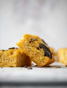 This pumpkin focaccia is slightly spice and covered with salted pepitas, parmesan and crispy sage. It's delish! howsweeteats.com