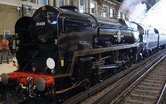 Merchant Navy Class steam locomotive, No. 35028 Clan Line at Victoria station, London,