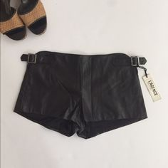 Make me an offer L'Agence leather shorts Black leather short shorts lined with side buckles. Adjustable fit. Fits like a 4. L'AGENCE Shorts